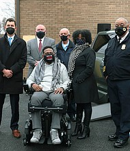 Following a shooting outside his home in August 2019, Sgt. Isaac Carrington, then a 22-year veteran of the Baltimore Police Department, spent weeks at Shock Trauma recovering. On Tuesday, January 5, 2020, he got a lift when representatives from MileOne Autogroup and its nonprofit arm Wheels for Change, The Signal 13 Founda- tion and the Baltimore City Lodge #3 Fraternal Order of Police presented him with a handicap accessible van. The organizations joined forces to raise the necessary funds for the vehicle totaling over $70,000, which was outfitted by and purchased from Bedco Mobility. Photo: (Left to right) Nancy Hinds, Signal 13 Foundation; Michael Fader, MileOne; Mike Mancuso, Fraternal Order of Police; Sgt. Isaac Carrington and wife Michelle (in front); Jerry Heid (liaison officer between BPD and Signal 13); and BPD Commissioner Michael Harrison.