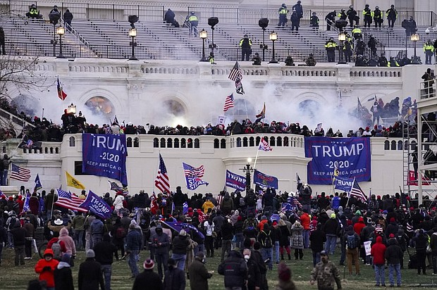 Violent protesters, loyal to President Donald Trump, storm the Capitol, in Washington, D.C. on Jan. 6 as Congress began a joint session of the House and Senate to certify President-Elect Joe Biden's Electoral College victory last Nov. 3.   (AP photo)