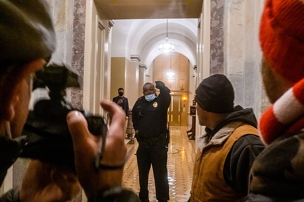 Capitol Police Officer Eugene Goodman confronts Pro-Trump supporters Jan. 6, 2021, as they break into the U.S. Capitol to protest the certification of Joe Biden as the next United States president.