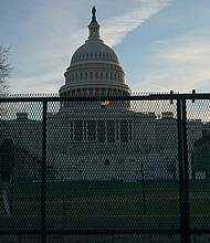 Protective fencing up at the US Capitol, several days after a pro-Trump mob stormed the building.
