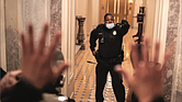 U.S. Capitol Police Officer Eugene Goodman single-handedly holds off insurrectionists, keeping them from entering the U.S. Senate from a section of the U.S. Capitol on Jan. 6.