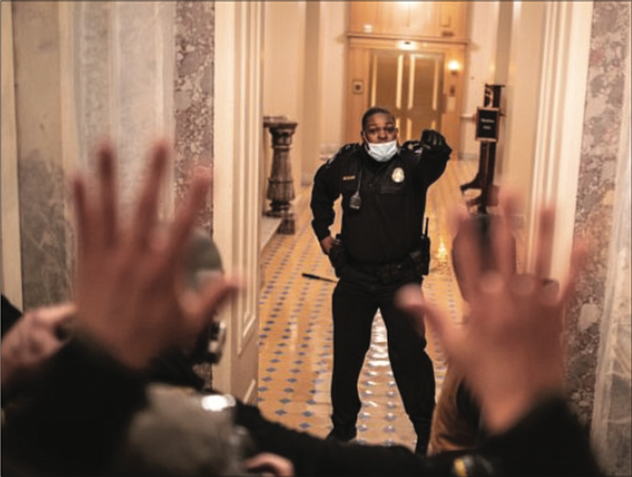 A Black U.S. Capitol Police officer is being hailed a hero for steering an angry mob away from the U.S. ...