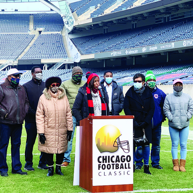 LaToyia Huggins, executive director of Christmas in the Wards, talks about the importance of the partnership between Christmas in the Wards and the Chicago Park District. Photo by Tia Carol Jones