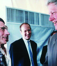 Dr. Anthony Fauci (left) was appointed director of NIAID in 1984 and has served under six presidents. In this photo, President Bill Clinton (right) visits the National Institutes of Health in 1995 and hears about the latest advances in HIV/AIDS research from Fauci.