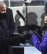 Former President Barack Obama greets Vice President-elect Kamala Harris ahead of President-elect Joe Biden's inauguration, Wednesday, Jan. 20, 2021, at the U.S. Capitol in Washington.
