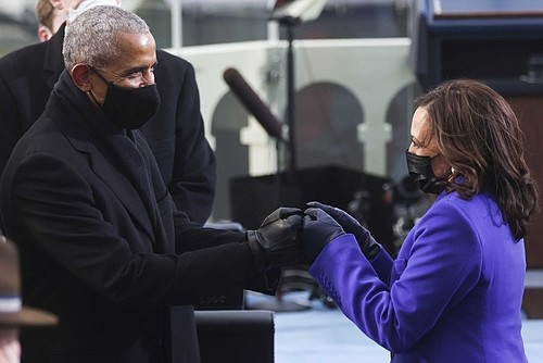 Former President Barack Obama greets Vice President-elect Kamala Harris ahead of President-elect Joe Biden's inauguration, Wednesday, Jan. 20, 2021, at the U.S. Capitol in Washington.