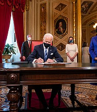 Joe Biden signs three documents including an inauguration declaration, cabinet nominations and sub-cabinet nominations in the President's Room at the US Capitol after the inauguration ceremony, Wednesday, Jan. 20, 2021, at the U.S. Capitol in Washington.