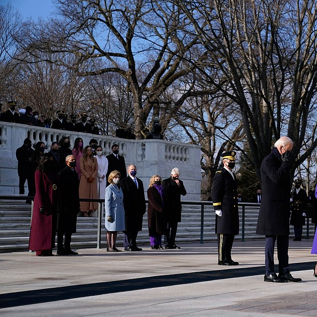 President Joe Biden and Vice President Kamala Harris place a wreath at the Tomb of the Unknown Soldier at Arlington National Cemetery as three former presidents and their wives look on. They are, from left, former President Barack Obama and his wife, Michelle; former President George W. Bush and his wife, Laura; and former President Bill Clinton and his wife, former Secretary of State Hillary Clinton.