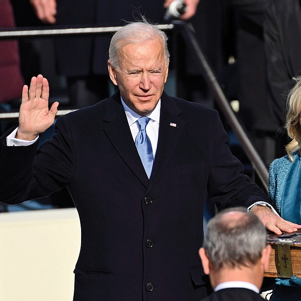 Joseph R. Biden Jr. is sworn in as the 46th president of the United States by U.S. Supreme Court Chief Justice John Roberts as his wife, Jill Biden, holds a Bible that has been in the family since the 1800s.
