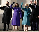From right, President Joe Biden, his wife Jill Biden, and Vice President Kamala Harris and her husband, Doug Emhoff wave to a small, but cheering crowd as they arrive on the steps of the U.S. Capitol for the start of the official inaugural ceremonies Wednesday.