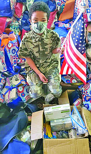 "Tyler, 9, has given away thousands of his ""Hero Bags"" and ""Hero Boxes"" with toiletries, clothing and other items to thank veterans."
