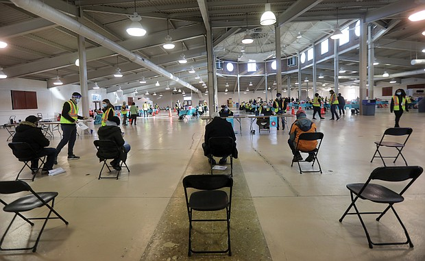 The cavernous Old Dominion Building at Richmond Raceway offers enough space for vaccination stations to be socially distanced and for people to wait safely for 15 minutes after being inoculated to ensure they do not have an adverse reaction. More than 1,000 people were inoculated against COVID-19 there on Tuesday.