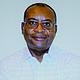 Author of The Engineering of Racism, Samuel Belsham Moki, PhD