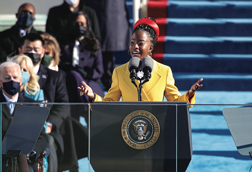 "Amanda Gorman, the na- tion's first-ever youth poet laureate, challenged Americans Wednesday to ""leave behind a country better than the ..."