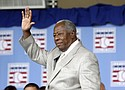 Hall of Famer Hank Aaron waves to the crowd in 2013 during Baseball Hall of Fame induction ceremonies in Cooperstown, N.Y.  Aaron, who endured racist threats with stoic dignity during his pursuit of Babe Ruth's home run record in the pre-steroids era, died Friday, Jan. 22, 2021. He was 86.  (AP photo)