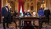 Shortly after the inaugural ceremony on Jan. 20, President Joe Biden gets to work signing documents in the President's Room at the U.S. Capitol.