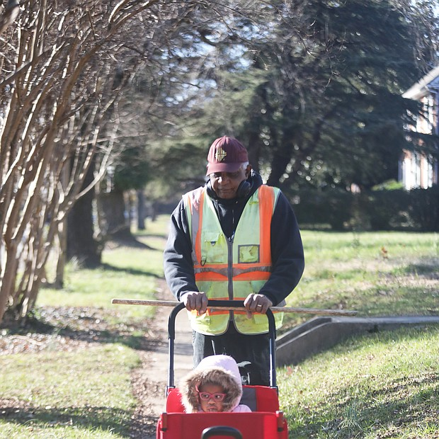 """Recent days with warm sunshine made it perfect for an outdoor stroll for Harris Wheeler, aka """"PaPa,"""" and his granddaughter Nia Rose Henderson, 2. The pair were enjoying a walk on DuBois Avenue in North Side."""