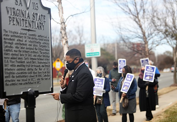 The Rev. Duane Hardy, pastor of Seven Pines Baptist Church in Sandston, leads a prayer during a vigil Jan. 22 near the site of the former Virginia State Penitentiary in Richmond seeking the abolition of the death penalty in the commonwealth. It was one of several vigils held around the state last week calling for the elimination of the death penalty.