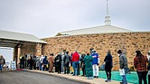 People line up for COVID-19 vaccinations outside Ebenezer Baptist Church in Oklahoma City, on Jan. 26, 2021.