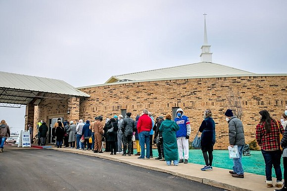 After more than 1,100 people received the coronavirus vaccine in the fellowship hall of a Black church in Oklahoma City, ...