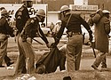 "An Alabama state trooper grabs a woman as police break up the 1965 Selma to Montgomery civil rights march pressing for voter registration rights for Black Americans across the South. The violent response by police became known as ""Bloody Sunday.""  (AP photo)"