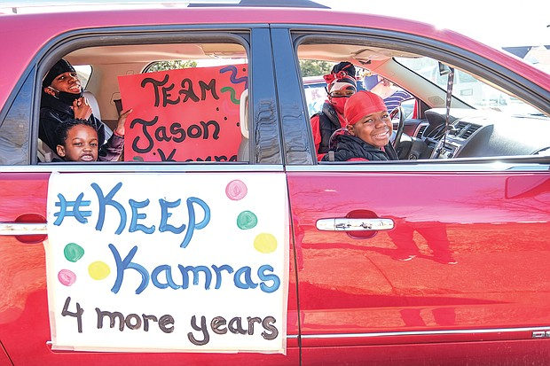 """The Erby family shows their support for Superintendent Jason Kamras and a four-year extension of his contract during an 80-vehicle, """"#KeepKamras"""" parade last Saturday in South Side. They are Richmond Public Schools students, from left, Elijah Erby, 5; Christopher Erby, 13; and Lamar Erby, 11, with their mom, Tisha Erby."""
