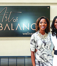Dr. Nia Banks and Dr. Aderonke Omotade pose in front of their business, Art of Balance Wellness Spa, the only one of its kind in the Baltimore, Ellicott City and Columbia, Marylanda region.
