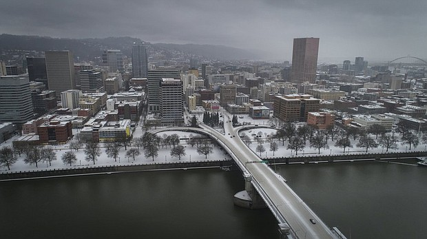 The Morrison Bridge and downtown Portland  is covered in ice and snow in a Feb. 12 photo from AP.