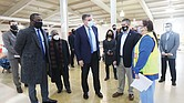 U.S. Sen. Mark R. Warner, center, thanks registered nurse Robin Gilbert of Henrico Health Services, who was overseeing nurses administering COVID-19 vaccinations Wednesday at the Richmond Raceway in Henrico County. Sen. Warner was joined on a tour of the inoculation site by, from left, Richmond Mayor Levar M. Stoney, Henrico's Fairfield District Supervisor Frank J. Thornton and tour guide, Jackson Baynard, Henrico County's chief of emergency management.