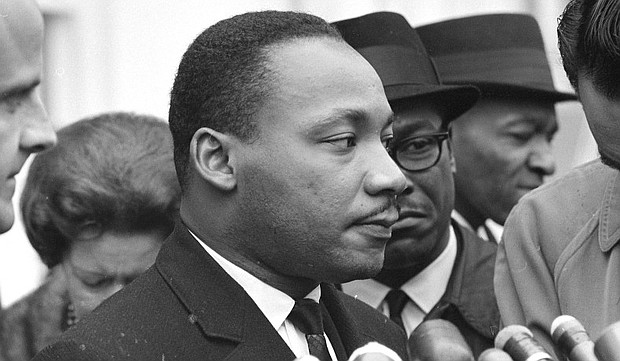 Martin Luther King Jr. speaks after a Dec. 3, 1963 meeting with President Lyndon B. Johnson to discuss civil rights. The new documentary MLK/FBI explores the FBI's obsession with King. (National Archives photo)