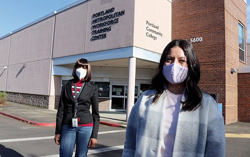 Student Nahlee Suvanvej (right) and her career mentor Tracee Wells are pictured outside the Portland Metro Workforce Training Center, located at Northeast 42nd and Killingsworth.