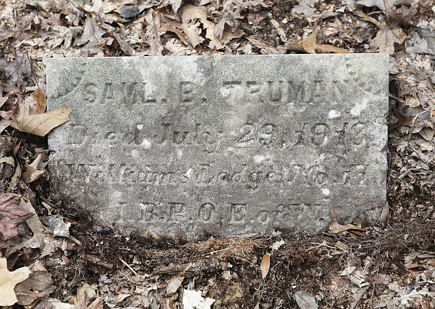 The small marker rests at the grave of Samuel Truman, grandson of Abraham Truman, who bought the land to farm following the Civil War. Samuel Truman died at age 28 from typhoid fever, according to records.