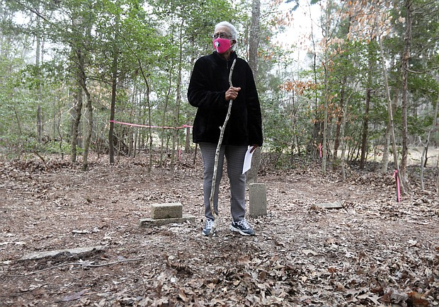 Carolyn Bradford Moten stands among the headstones in an unmarked cemetery that was found on land off Long Bridge Road in Eastern Henrico County that is now owned by the Capitol Region Land Conservancy. The land was purchased in 1874 by Abraham Truman and stayed in the Truman family until 1979. Ms. Moten is his great-niece.