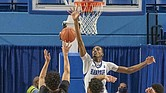 Hampton's Dajour Dickens goes up to block a shot.