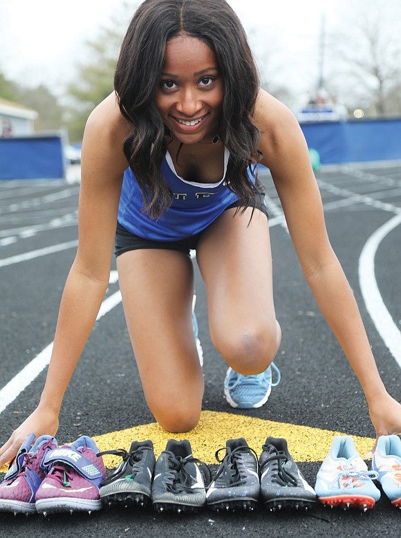 Atlee High School junior Jada Foreman is easily spotted at track and field meets. She's likely the one carrying the ...