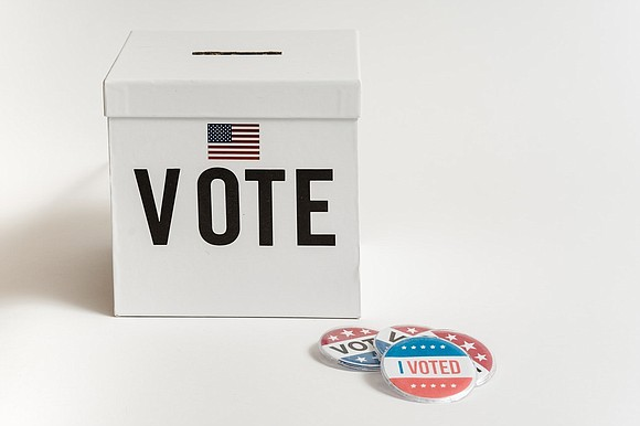 """The use of """"poll watchers"""" and law enforcement officers stationed at polling sites intimidating Black voters is becoming a major ..."""