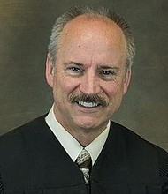"Clark County District Court Judge Darvin Zimmerman has decided to take time off to reflect on his behavior after a hot microphone in his courtroom captured the judge ridiculing the victim of a police shooting as ""the Black guy they were trying to make an angel out of."""