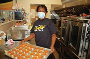 Jamie Turner works the kitchen as the owner and operator of Ja'Das Soulful Eatz, expanding her catering and food cart business into a new family soul food restaurant next door to the Miracles Cub at 4200 N.E. Martin Luther King Jr. Blvd.