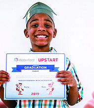 Fredrick Adams Jr. receives his diploma at the Waterford Upstart Summer Learning Path graduation in Bolivar County, MS. Offered by Waterford.org, the free program helps to ensure children stay on track over the summer. The program seeks to support students and families who have been affected by COVID-19 either through personal economic hardship or due to the indefinite closure of many PreK and Head Start options. The program provides a free computer and Internet services to families who need them. Last year, 13,000 children across the nation participated in the program.