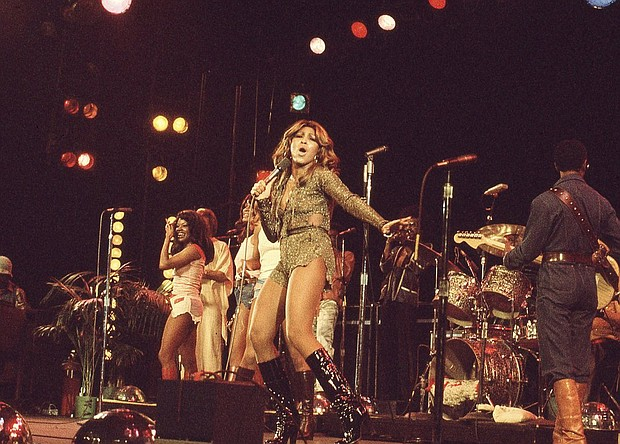 """Tina Turner performs in this image from 1976 released by HBO for the new documentary """"Tina."""" (Photo via AP)"""