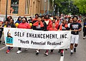 Youth from Self Enhancement, Inc. celebrate unity in the community in this Portland Observer photo from the 2018 Good in the Hood parade.