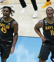 Baylor guard Davion Mitchell (45) and Baylor guard Mark Vital (11) celebrate an 86-70 championship win against Gonzaga Monday in the NCAA college basketball tournament in Indianapolis.   (AP photo)