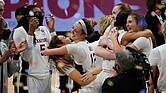 Stanford players celebrate after clinching the NCAA crown Sunday at the buzzer with a 54-53 victory over Arizona at the Alamodome in San Antonio, Texas.