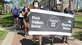 More than 100 University of Richmond students, along with faculty and staff, march Wednesday in a demonstration led by the Black Student Coalition calling for the names of Rev. Robert Ryland and Douglas Southall Freeman to be removed from campus buildings.