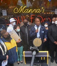 Manna's Restaurant owner Betty Park receives a proclamation from city officals