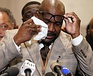 George Floyd's brother, Philonise Floyd, wipes his eyes during a news conference after the verdict was read Tuesday in Minneapolis in which former police officer Derek Chauvin was convicted of the murder of George Floyd.  Below, Andre Tolleris waves a flag and yells in jubilation to passing motorists Tuesday at Monument and Allen avenues. Many of the drivers and passengers honked their horns in celebration.