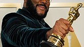 Tyler Perry, winner of the Jean Hersholt Humanitarian Award, holds his Oscar at the Academy Awards in Los Angeles.