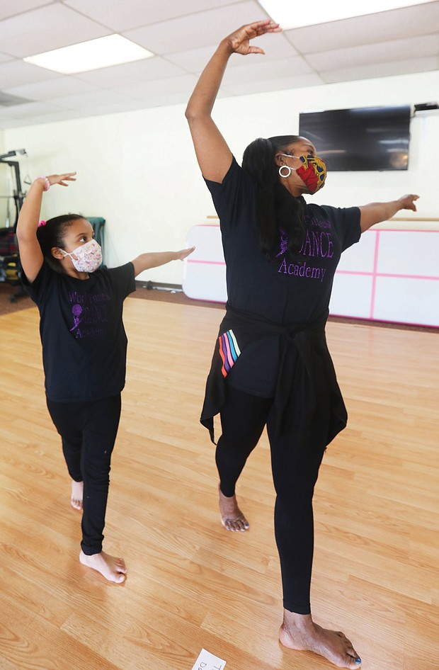 Me and my shadow-Daphne Lions, 6, mirrors dance techniques taught last Saturday by her instructor, Cynthia Thomas Rustin, owner and operator of World Fitness Dance Academy in Glen Allen. As part of COVID-19 safety protocol, dance students wear masks, have their temperatures taken, wash their hands and feet and stay socially distanced.
