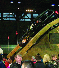 A Jeep on an artificial hill at the Chicago Auto Show in 2007. Recently, elected officials announced the return of the annual Chicago Auto Show, a marquee event that draws tourists from around the world.