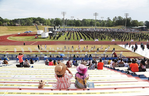 Graduates' families and friends are seated socially distanced in the stadium during Virginia State University's commencement.